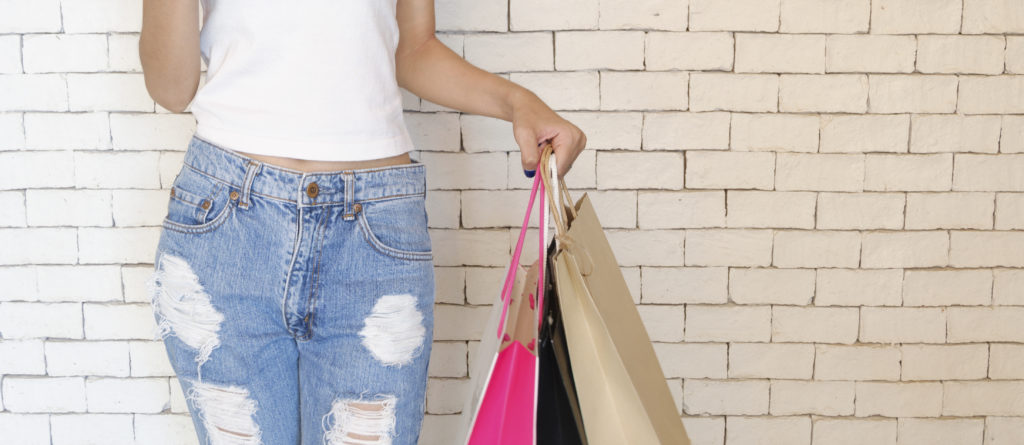 Closeup of woman holding shopping bags with copy space